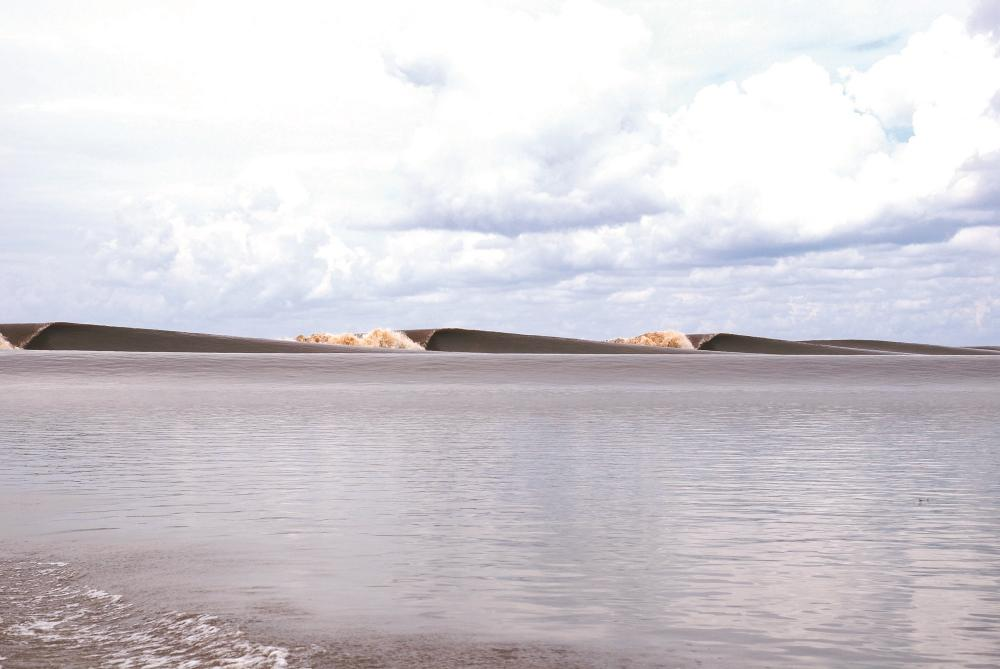 Bono River Photos by Antony Colas who discovered this incredible tidal bore wave using Google Earth
