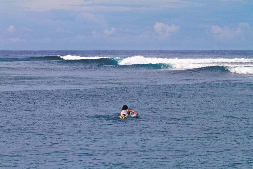 Phil Goodrich, paddling into virgin surf 1,000 Km North-East of Bali. Photo Thanks John S Callahan tropicalpix